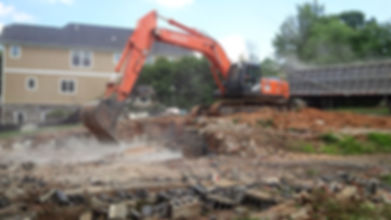 Our excavator demolishing a house foundation in McLean, VA.