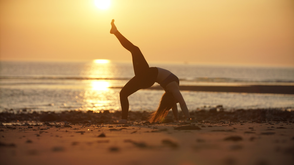 Yoga on the beach. Not that we can do that right now... Photo: Maja Gobelli