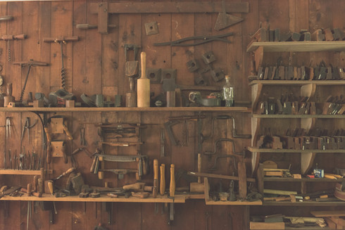 assorted%20hand%20tool%20lot%20on%20brown%20wooden%20shelf_edited.jpg