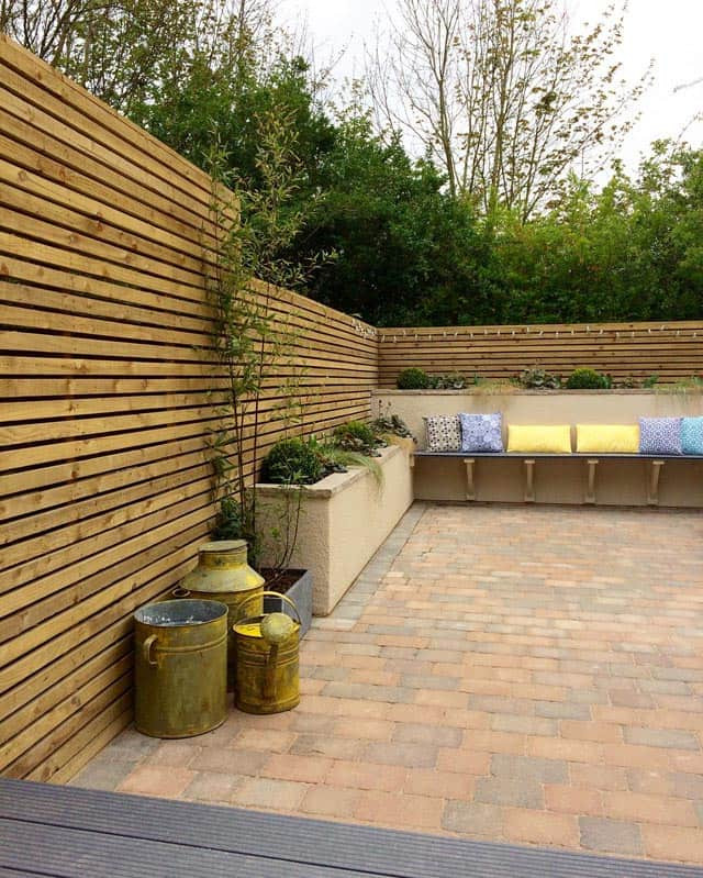 Block paved courtyard with composite decking and seat in West Bridgford