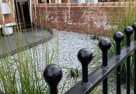 Traditional railings, limestone path with Victorian edging and decorative pebbles planted with grasses in West Bridgford