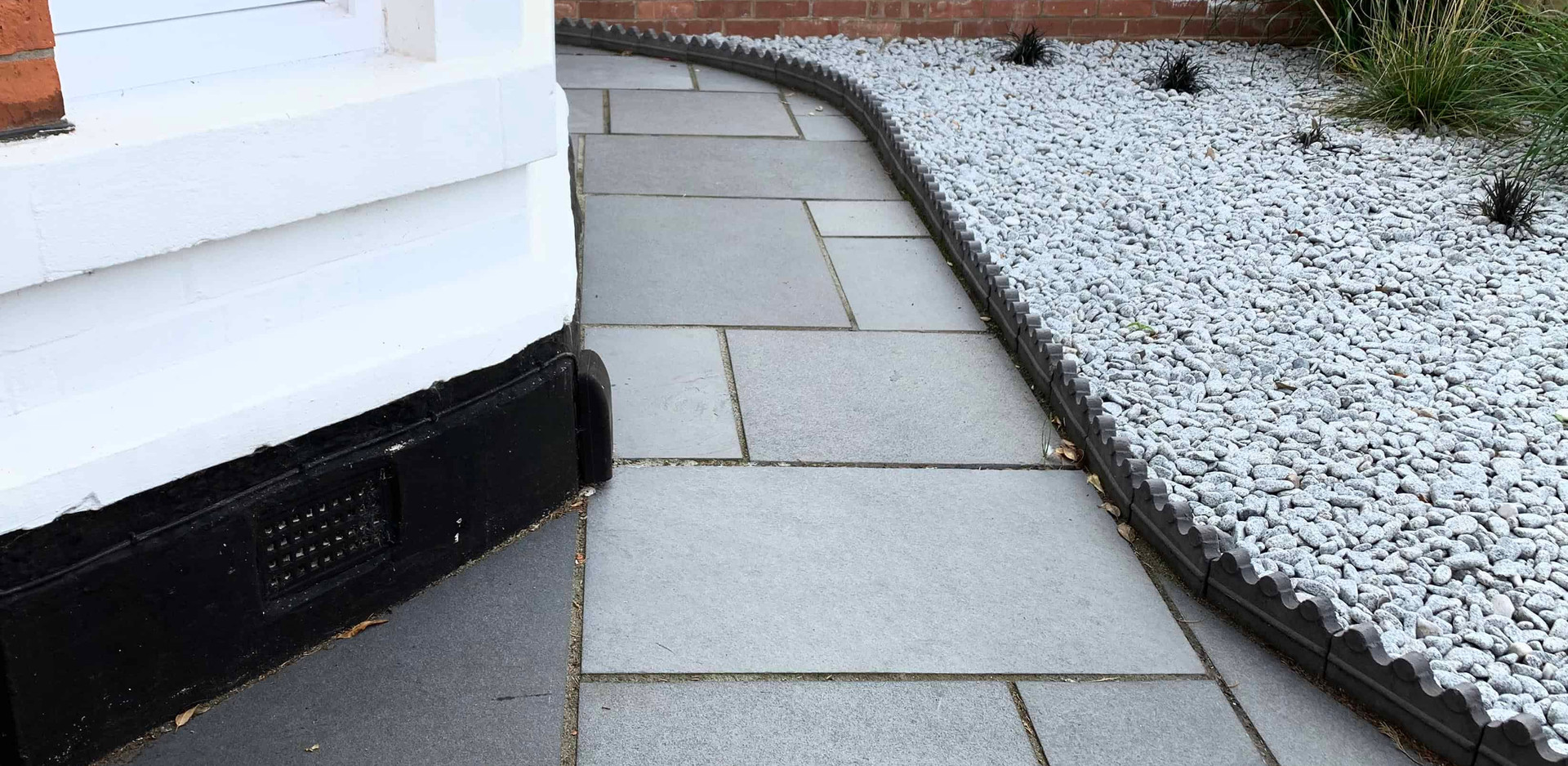 Limestone path with Victorian edging and decorative pebbles in West Bridgford