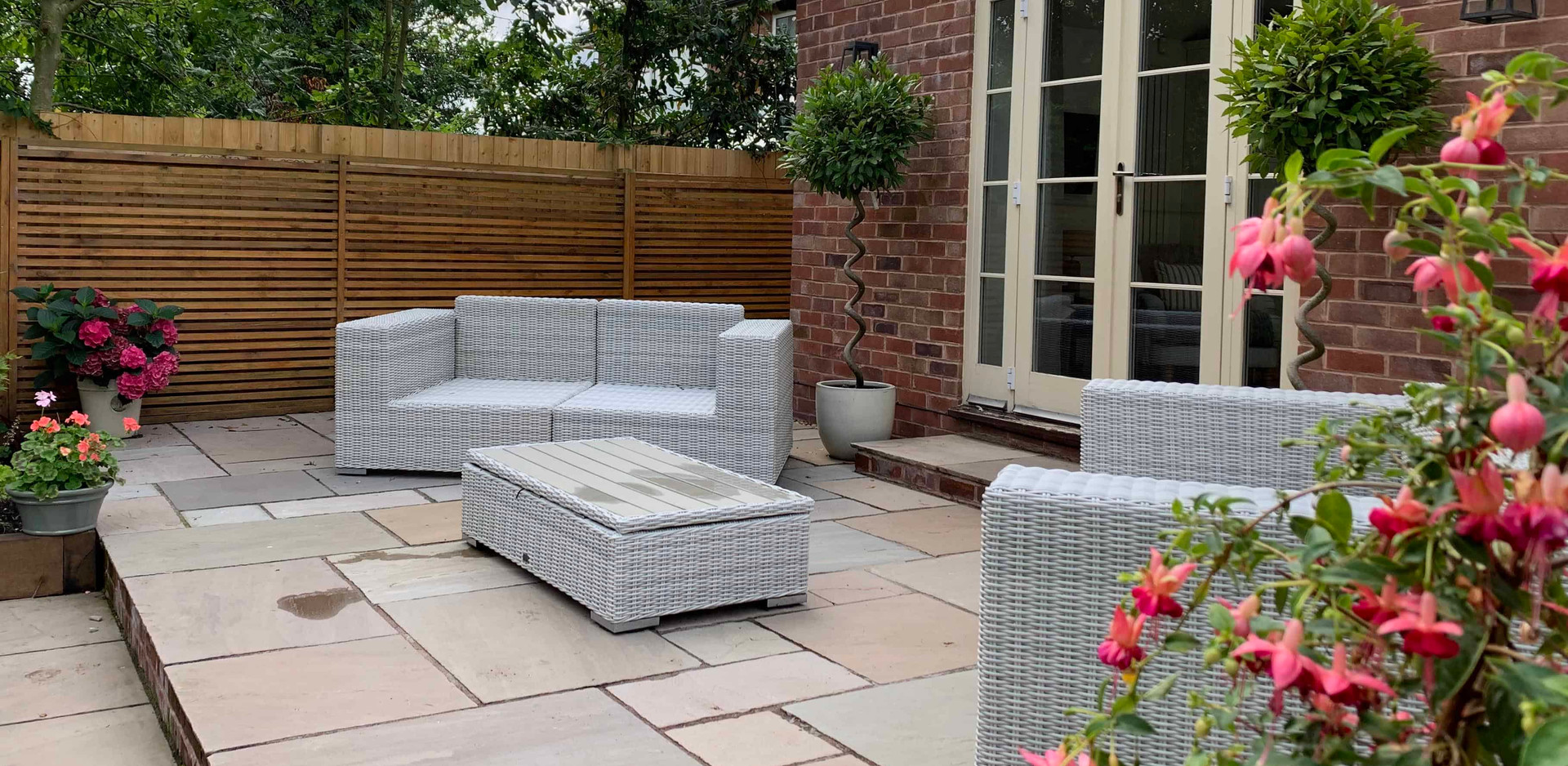 Antique Tumbled Indian Sandstone paved patio in Aslockton