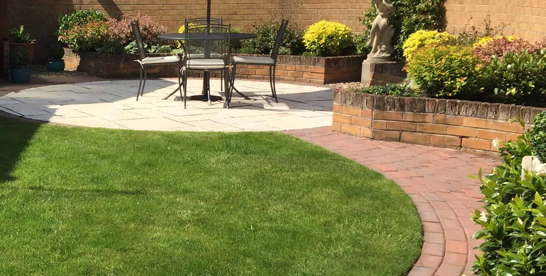Turfing with a block lawn edge and path and patio in Bingham