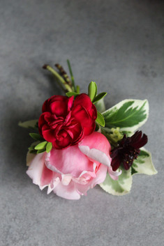 Shades of pink and red buttonhole.JPG