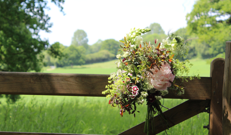 entrance-flowers-peony-wedding-tunbridgewells.jpg