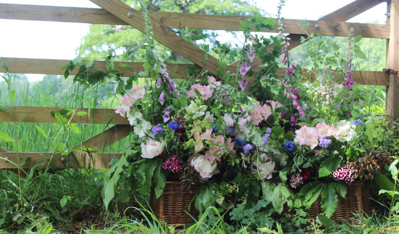 entrance-flowers-meadow-wedding-tunbridgewells.jpg