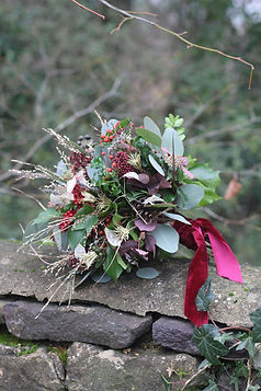 Winter Bouquet Stone Wall Green Red with