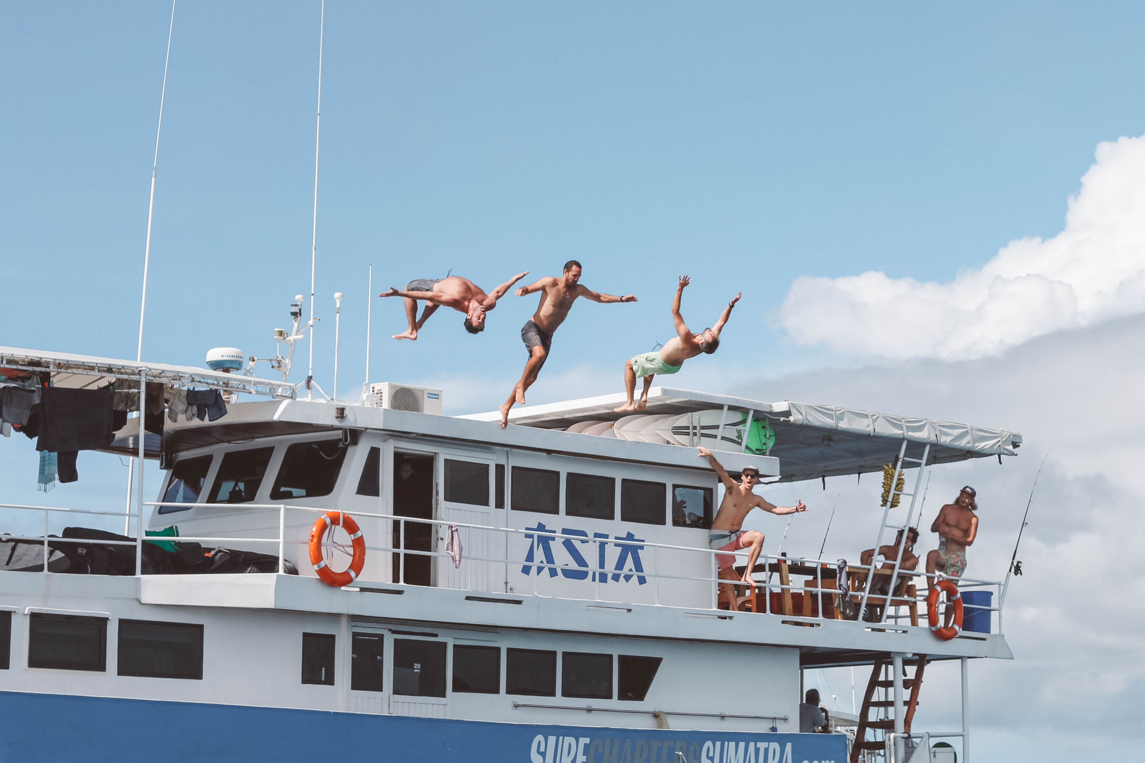 ASIA Boat Surf Charter Mentawai Side View Jumps.png