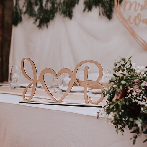 Initials joined by heart with base