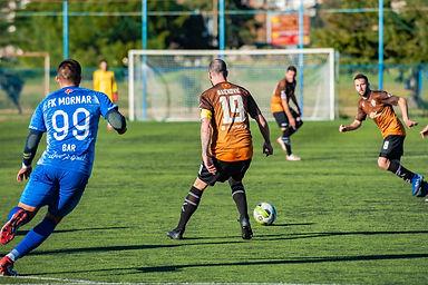 photo-of-men-playing-soccer-during-dayti
