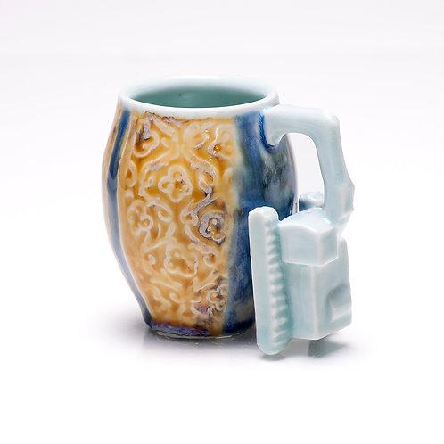 Excavator mug with etchings and celadon