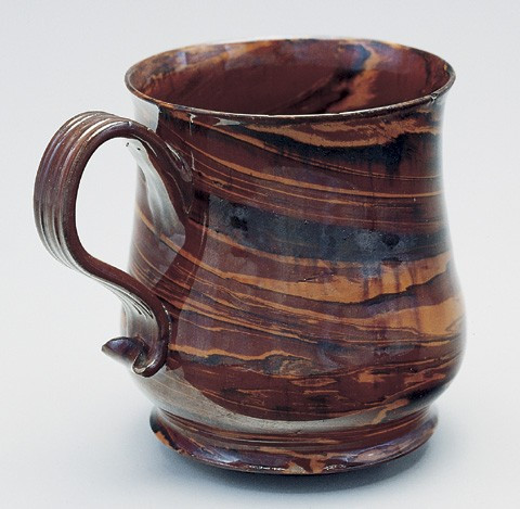 "Mug, attributed to Samuel Bell, Staffordshire (Newcastle-under-Lyme), ca. 1740. Lead-glazed agateware. H. 4 1/2"". (Courtesy, Troy D. Chappell Collection; photos by Gavin Ashworth unless otherwise noted.)"
