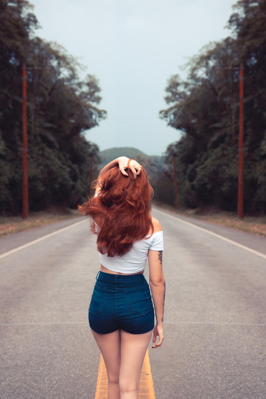 woman red hair walking