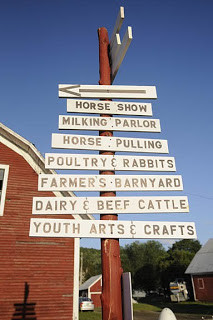 Sign showing event locations at country fair