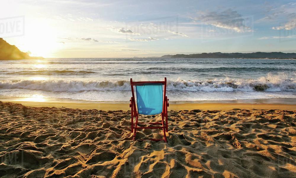 Beach chair on sand at seashore