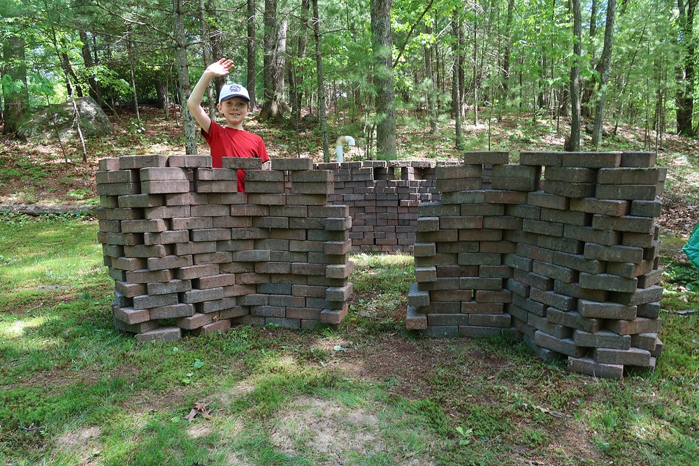 Homemade castle play area built of layered bricks