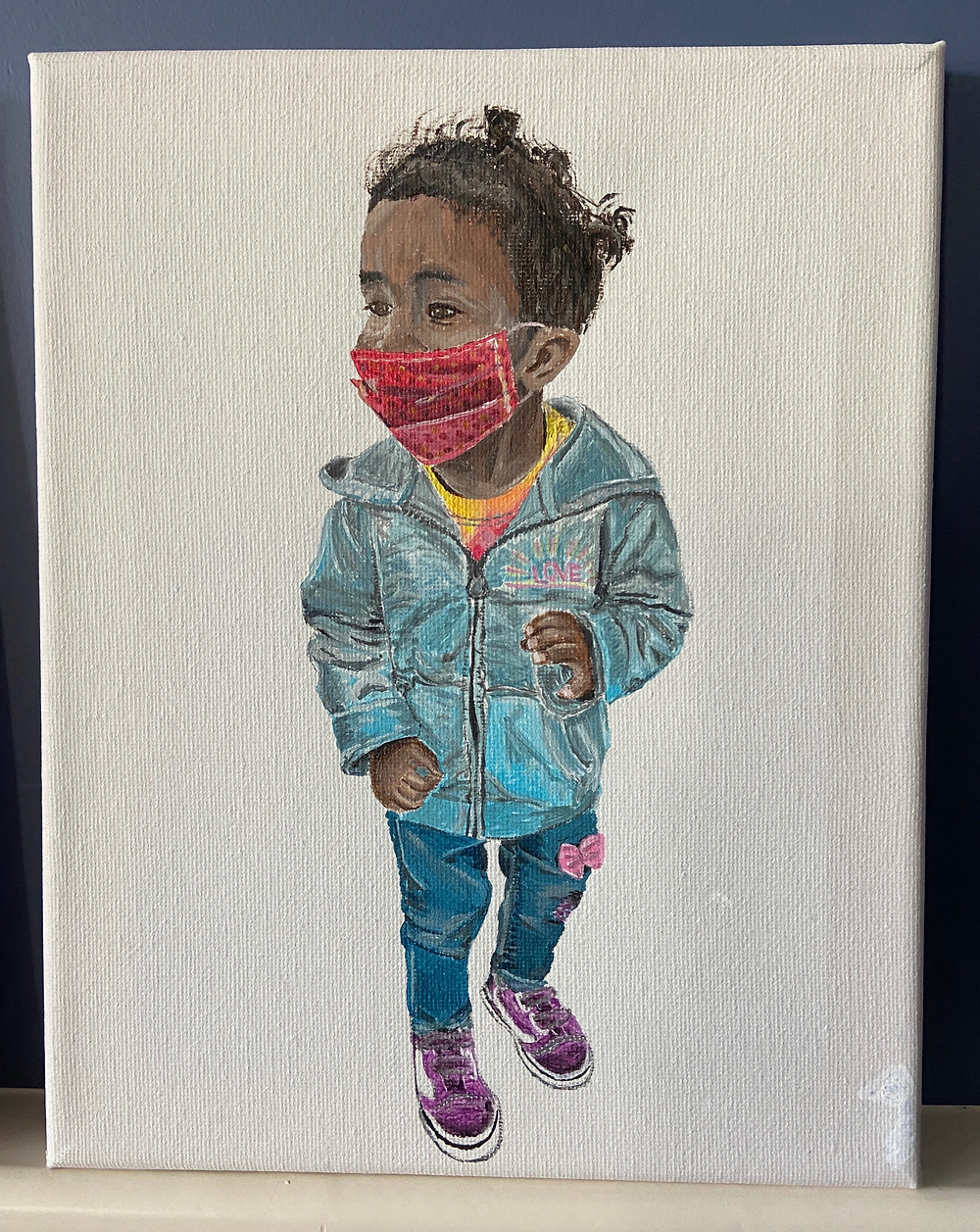 An acrylic painting of a 2 year old girl wearing her mask.