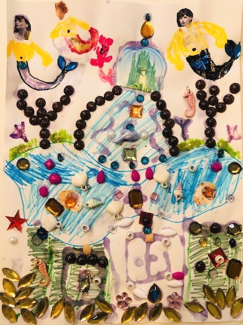 Multimedia image using colorful found objects like jewels and rocks.