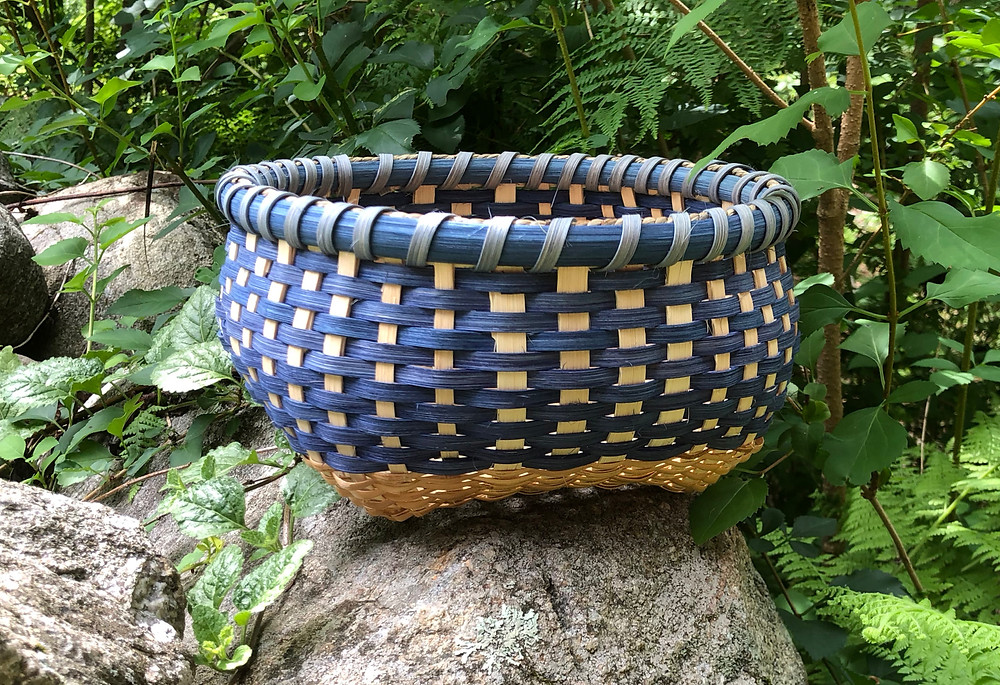 Blue and tan woven reed basket