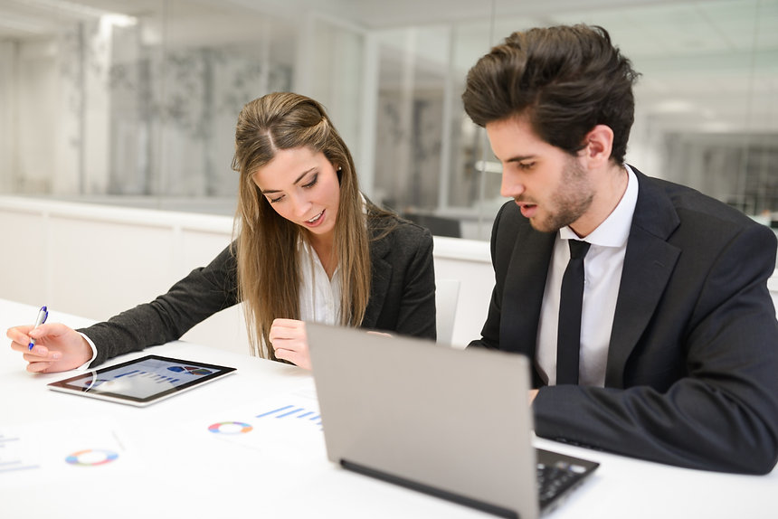 employees-reviewing-financial-report.jpg