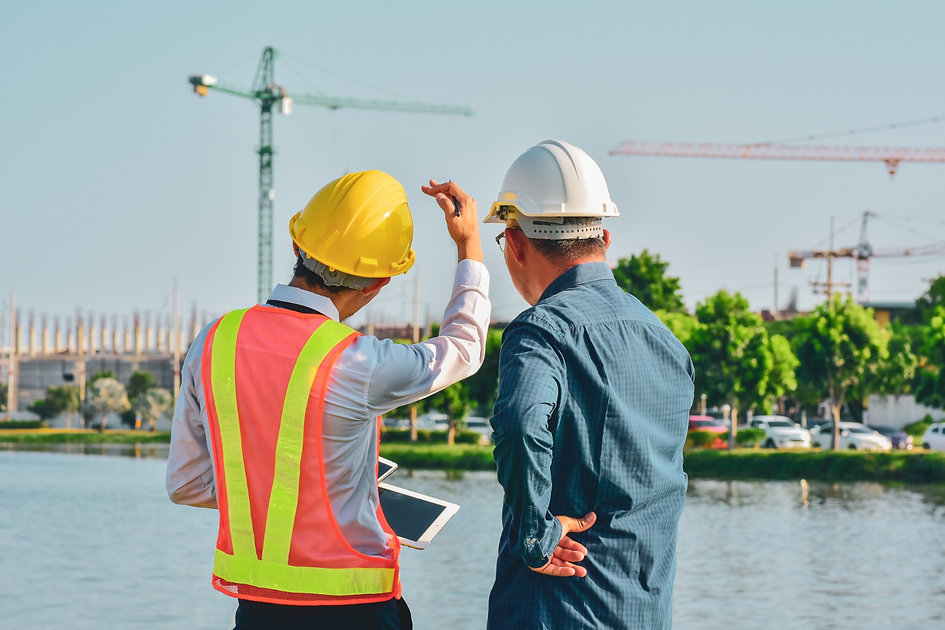 two-engineer-talking-plan-construction-site-project.jpg