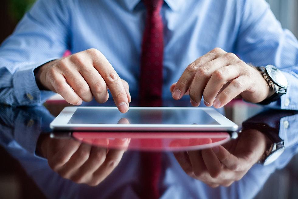 close-up-professional-businessman-using-modern-digital-tablet-his-office.jpg