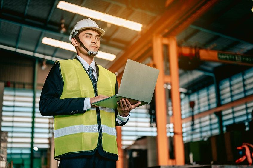 asian-woman-engineer-industry-wearing-hardhat-holding-checklist-standing-machine-area.jpg
