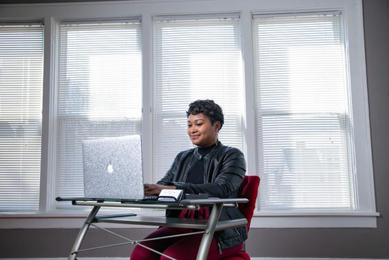 Black Woman using computer personal bran