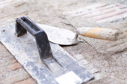 Small hand tools, a float trowel and a m