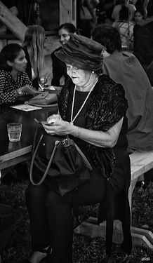 Woman using a mobile phone in black and white