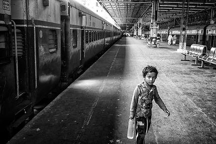 Boy in Mumbai gathering drinking water.