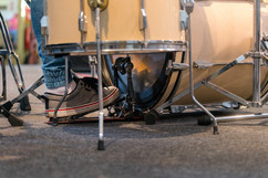 drummer-playing-drum-set-stage-concertBA