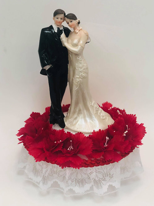 Wedding Couple with red flowers