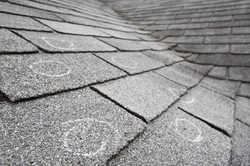 bigstock-Old-roof-with-hail-damage-cha-16442648-2