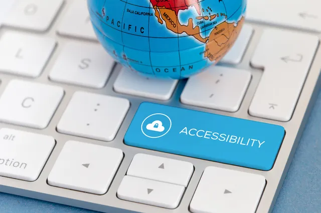A small globe sits on top of a keyboard next to a keyboard button titled ACCESSIBILITY