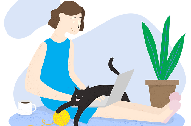 Woman sitting on the floor using her laptop. A cat is stretched out over the keyboard.