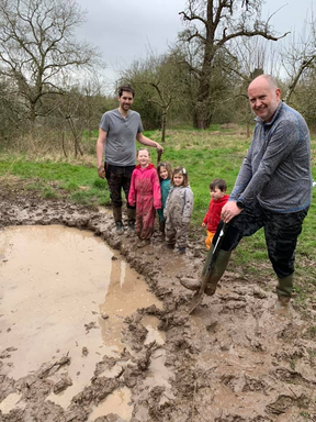 Volunteers digging a pond in Trotshill Community Orchard