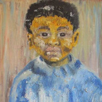 Portrait of a young boy from Montreal wearing a blue sweater