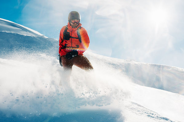 snowboarder-is-standing-in-the-red-suit-
