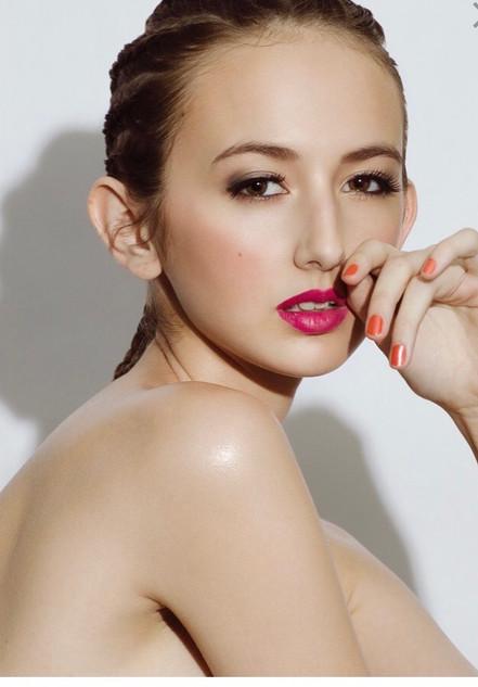 Celebrity makeup artist Casey Cheek Client poses