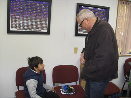 """TSE Employee Being """"Good Neighbor,"""" Providing Free Shoes to Children in Need"""