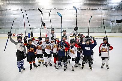 Hockey Team Sticks High Pose.jpg