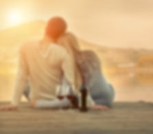 Romantic Couple sitting on the pier with