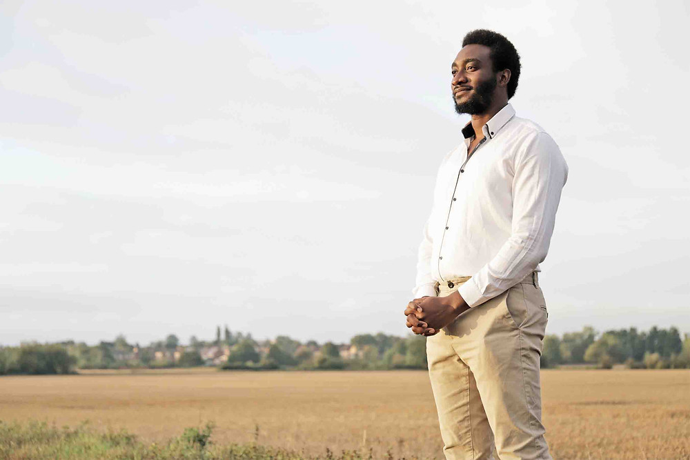 Tolu standing in the field | The Death Of My Spouse, Chidinma | Balanced Wheel | BW