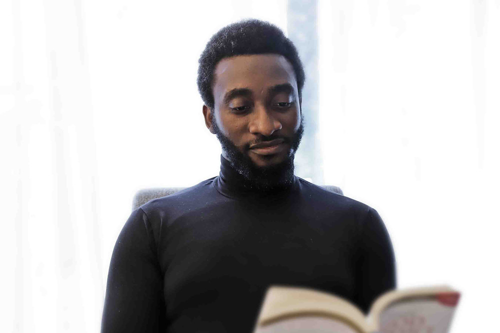Tolu Olajide reading a book | Planning the Funeral of My Wife During Covid-19 | Balanced Wheel | BW