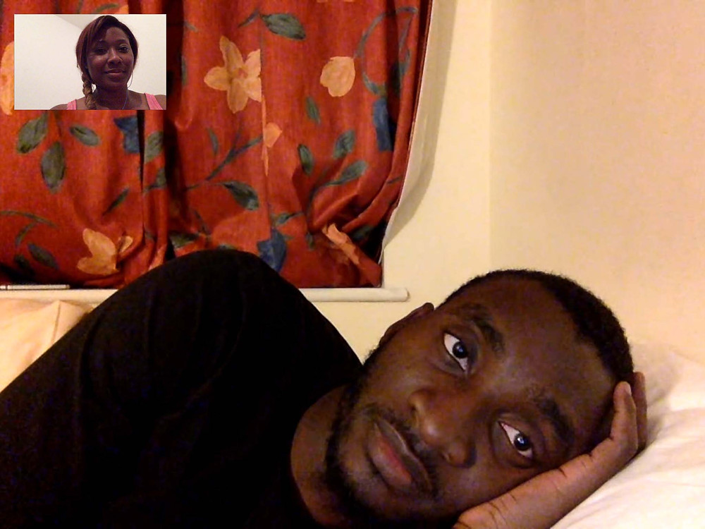 Tolulope Olajide appears to having a facetime video conversation with Chidinma Onuzo as he rests his head on the bed. Balanced Wheel | BW