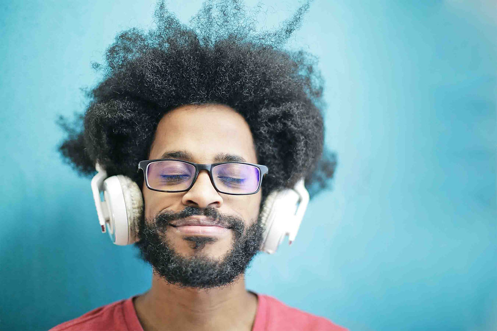 Man listening to music with headphones and eyes closed | Balanced Wheel