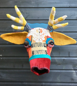 Colourful textile stags head