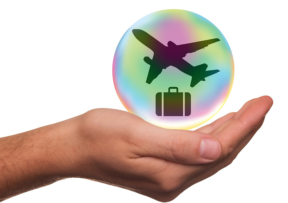 A hand with travel insurance